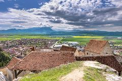 Spring view over the Rasnov city, in Brasov county (Romania), with old houses of the Rasnov citadel in the foreground and Piatra royalty free stock photos
