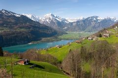 Spring view over Walensee. With snowy mountain peaks on the background Stock Photography