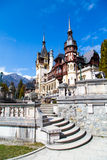 Spring view of Peles Castle with snow Bucegi Mountains in the background. Stock Images