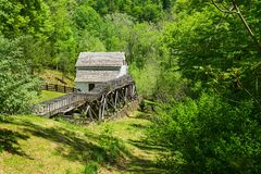Spring View of Slone's Grist Mill – Explore Park, Roanoke, Virginia, USA. Roanoke County, VA – May 6th; Spring view Slone's Grist stock photos