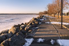 Spring View of Sylvan Beach Shoreline. On Oneida Lake during Sunset while the Lake is Still Frozen stock image
