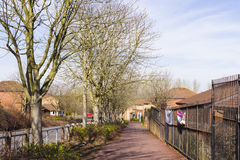 Spring view at Two Mile Ash area in Milton Keynes, England. MILTON KEYNES, ENGLAND - MARCH 03, 2015: Sunny view at streets and residential buildings of Two Mile stock images