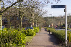Spring view at Two Mile Ash area in Milton Keynes, England. MILTON KEYNES, ENGLAND - MARCH 03, 2015: Sunny view at streets and residential buildings of Two Mile Royalty Free Stock Photos