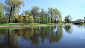 Spring  views scenic river. Landscape of a green field with trees and a bright blue river stock footage