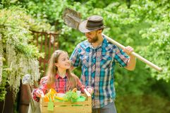 Spring village country. little girl and happy man dad. earth day. ecology. Gardening tools. family farm. summer farm royalty free stock image