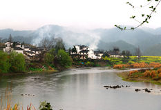 SPRING IN VILLAGE WITH RIVER. Photoed it in Wuyuan, JiangXi, China, the most beautiful village in china in spring.  Ancient anhui antique apartment architecture Stock Photo