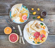Spring vitamin breakfast set. Thin crepes or Royalty Free Stock Image