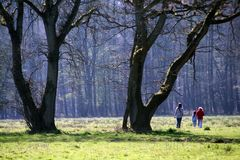 Spring Walk. Tree people taking a nice walk in the English countryside on a lovely spring day Royalty Free Stock Images