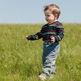 Spring walk of a toddler Royalty Free Stock Photo