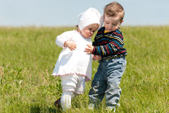 Spring walk of two toddlers Royalty Free Stock Photos
