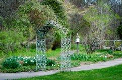 Spring walking paths at Fernwood gardens. Beautiful walking paths under arched trellises and through budding, colorful woods. Fernwood Botanical Gardens and Stock Photography
