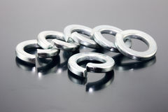 Spring washers. On color background Stock Photo