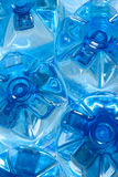 Spring water. Blue plastic bottles with spring water, bottom view Royalty Free Stock Photos