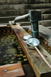 Spring Water. Hold Water at the entrance to a temple stock photography