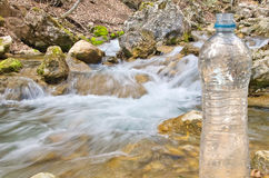 Spring water and bottle Royalty Free Stock Image