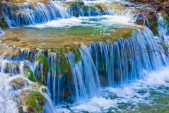 Spring water cascades. On a mountain river Stock Images