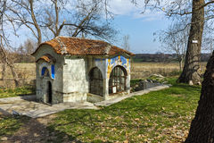 Spring of water and small church in Arapovo Monastery of Saint Nedelya, Bulgaria Royalty Free Stock Image
