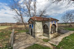 Spring of water and small church in Arapovo Monastery of Saint Nedelya, Bulgaria Royalty Free Stock Photography