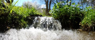 Spring waterfall Stock Photo