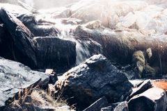 Spring waterfall in the rocks. Mountain river stock image