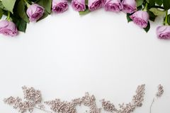 Spring wedding flowers pink roses arrangement. Spring wedding flowers decor. Pink roses with silver adornment on white background. Elegant and tender reception Royalty Free Stock Photography
