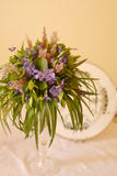 Spring wild flower bouquet. Wild flower bouquet with spring forest flowers from Transylvania on a vintage tray with violets Stock Image