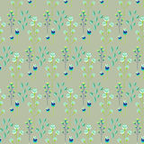 Spring wild flower khaki millefleurs field seamless pattern. Floral tender fine summer vector pattern on green background. For fabric textile prints and Stock Image