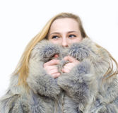 A spring will come soon. A girl in a fur coat by a cold winter holds a butterfly Stock Photography