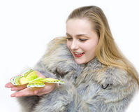 A spring will come soon. A girl in a fur coat by a cold winter holds a butterfly Stock Images