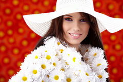 Spring woman. Dressed flower coat posing  on flowers background Royalty Free Stock Photo