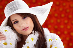 Spring woman. Dressed flower coat posing  on flowers background Royalty Free Stock Image