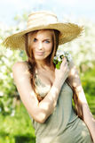 Spring woman. In summer dress walking in park Royalty Free Stock Images