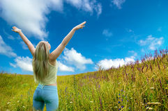 Spring woman. Happy woman having fun on spring meadow Stock Photography