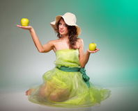 Spring woman with apple. Green concept Royalty Free Stock Image
