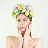 Spring Woman.Beautiful girl with easter eggs Stock Images