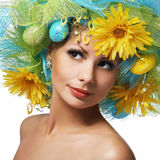 Spring Woman. Beautiful Girl with Easter Eggs and. Yellow Daisy Flowers. Model with Fashion Hairstyle Stock Photos