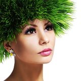 Spring Woman. Beautiful Girl with Green Grass Hair Royalty Free Stock Image