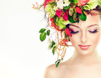 Spring woman. Beauty model girl with colorful flowers hairstyle Royalty Free Stock Photo
