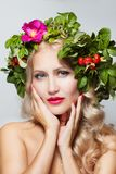Spring Woman. Beauty Summer model girl with colorful flowers wreath. stock images