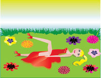 Spring woman. Blonde woman laying on a grass with flowers Stock Photos