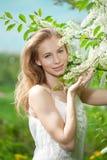 Spring woman blossoming garden Stock Photos
