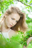 Spring woman blossoming garden Royalty Free Stock Image