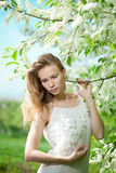 Spring woman blossoming garden Stock Images