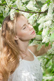 Spring woman blossoming garden Stock Photography