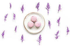 Spring woman breakfast with macaroons and flowers white background top view pattern Royalty Free Stock Photo