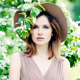Spring Woman in a Hat on Apples Blossom Stock Image