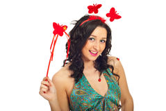 Spring woman holding butterfly wand Stock Images