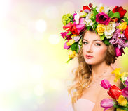 Spring woman portrait. Hairstyle with flowers Stock Images