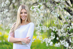 Spring woman portrait smiling outdoors in the park Stock Images