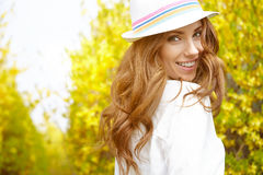 Spring woman in summer day. Walking in yellow park Royalty Free Stock Photos